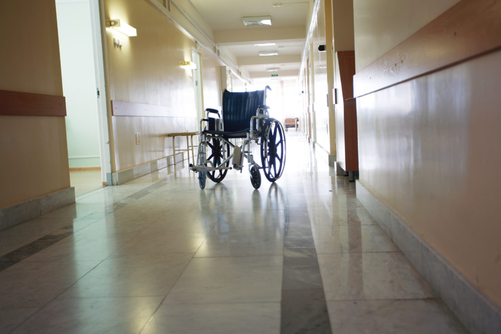 Long Term Care wheelchair alone in hallway